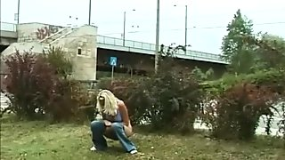 young blonde peeing in public