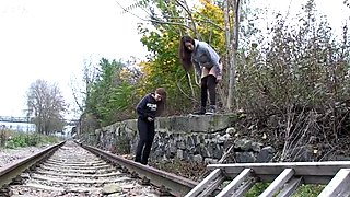 Two amateur brunette chicks wanna pee right on the train line