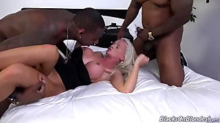 Busty blonde slut gets destroyed by two hung black studs