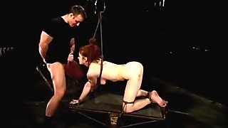 Tied redhead sucks cock and eating ass