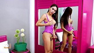 Sexy asian teen strokes her hard cock