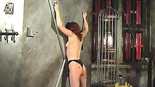 Skinny redhead slut has some dungeon fun with an ebony hussy