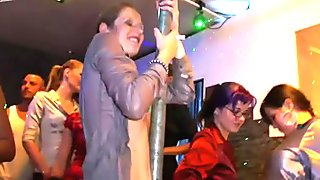 Dirty girls are pole dancing in a club