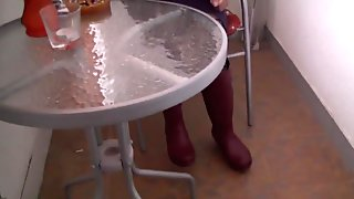 Squished under Her Rubber Boots