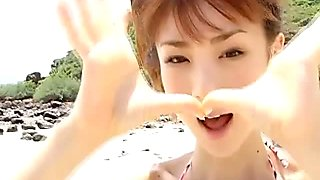 Japanese chick Aki Hoshino goes to the beach again