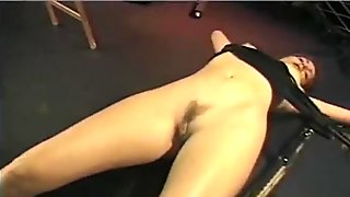 Naughty brunette bimbo lets her girlfriend spank her in the dungeon