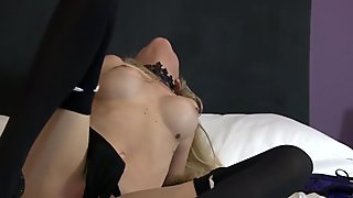 Sexy blonde milf masturbates with gloved fingers