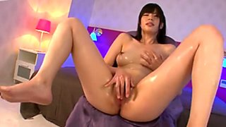 Cheesecake Japanese hussy Saki Aoyama pokes her fresh pinkish vagina with fingers